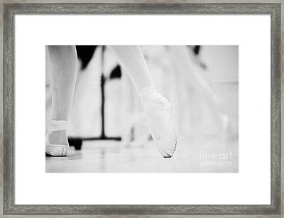 Pointed Toe In Ballet Slippers At A Ballet School In The Uk Framed Print by Joe Fox