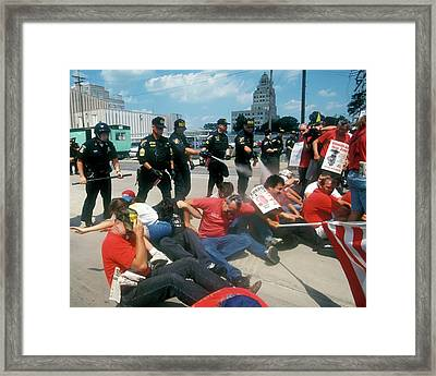 Police And Demonstrators Framed Print by Jim West