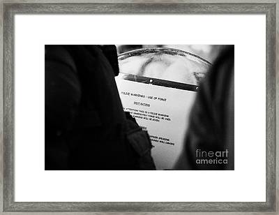 Police Baton Round  Riot Instructions On Inside Of Riot Shield On Crumlin Road At Ardoyne Shops Belf Framed Print by Joe Fox