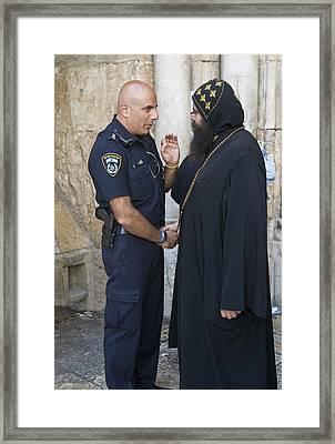 Policeman And Priest Framed Print by Kobby Dagan