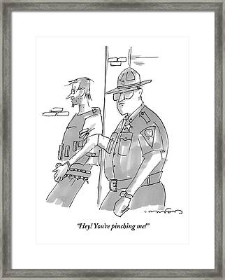 Policeman Is Squeezing Perps Arm And He Protests Framed Print