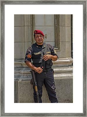 Policia Nacional Framed Print by Allen Sheffield