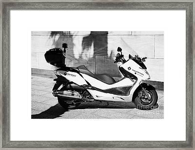 Policia Portuaria Port Police Moto Scooter Vehicle Port Of Barcelona Catalonia Spain Framed Print by Joe Fox