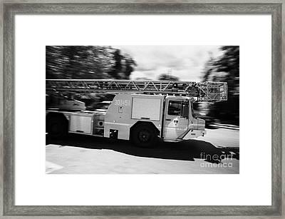 Polish Fire Brigade Fire Guard Straz Krakow Ladder Vehicle Speeding Past On Way To Fire Framed Print by Joe Fox
