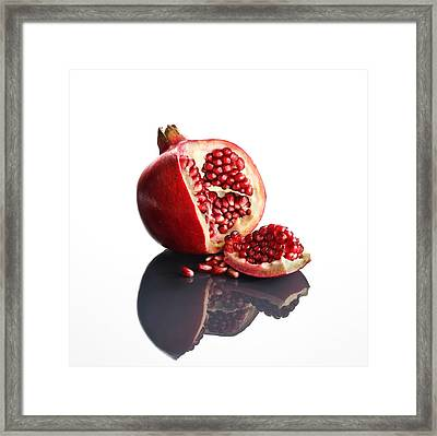 Pomegranate Opened Up On Reflective Surface Framed Print by Johan Swanepoel