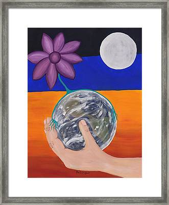 Pondering Creation Hand And Globe Framed Print by Barbara St Jean