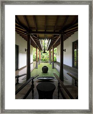 Pool With Leaves Next To Spa Framed Print