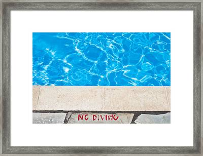 Poolside Warming Framed Print by Tom Gowanlock