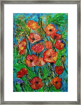 Poppies In Storm Framed Print by Janet Immordino