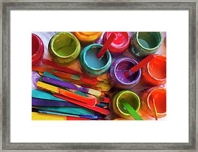 Popsicle Stick Paint Framed Print