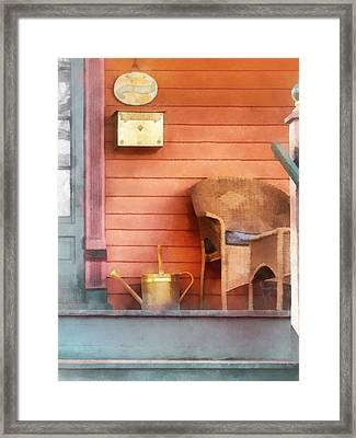 Porch With Brass Watering Can Framed Print