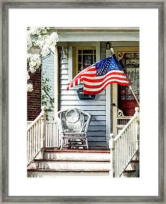 Porch With Flag And Wicker Chair Framed Print by Susan Savad