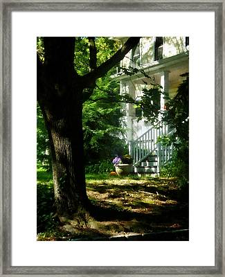 Porch With Pot Of Chrysanthemums Framed Print by Susan Savad