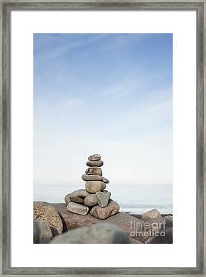 Porlock Weir Stone Stack Framed Print by Anne Gilbert