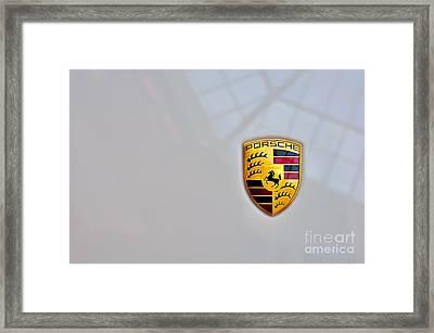 Porsche Emblem Framed Print by Andres LaBrada