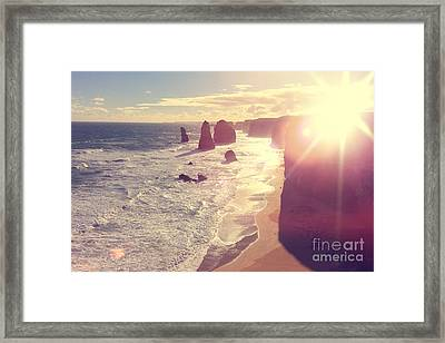 Port Campbell National Park Twelve Apostles With Sun Flare Framed Print by Beverly Claire Kaiya