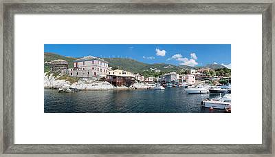 Port With Town At The Waterfront Framed Print