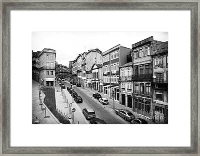 Porto Street Parking Framed Print by John Rizzuto