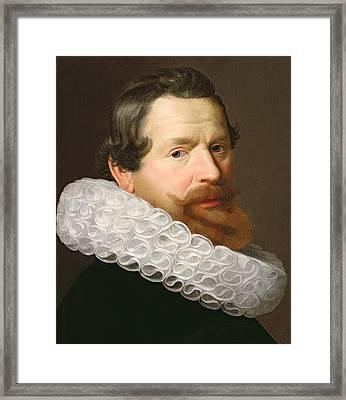 Portrait Of A Man Wearing A Ruff Framed Print by Dutch School