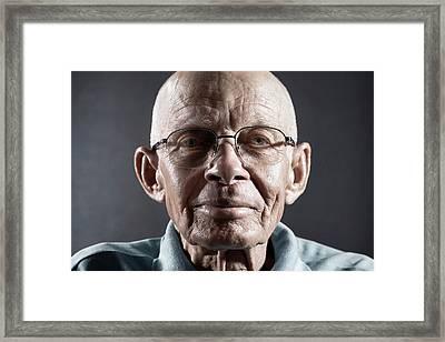 Portrait Of A Man Wearing Glasses Framed Print