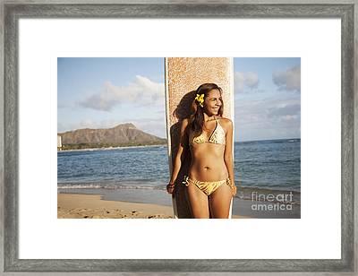 Portrait Of A Woman On A Beach In A Bikini Holding A Surfboard_ Waikiki, Oahu, Hawaii, United States Of America Framed Print by Brandon Tabiolo