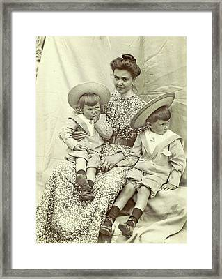 Portrait Of A Woman With Two Children With Sun Hats Framed Print by Artokoloro