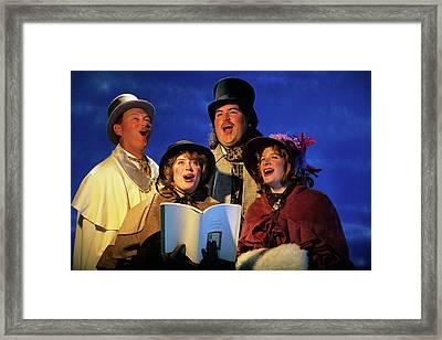 Portrait Of Four Christmas Carolers Framed Print