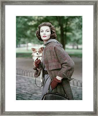 Portrait Of Va Taylor Carrying A Dog Framed Print by Frances Mclaughlin-Gill