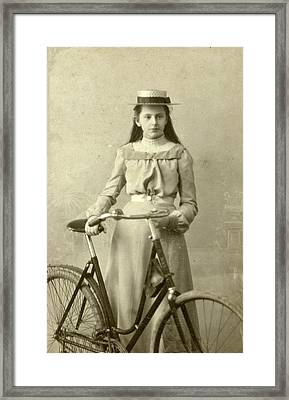 Portrait Of Young Woman In Dress With Ladies Bike Framed Print