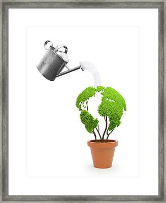 Pot Plant In Shape Of Earth Being Watered Framed Print by Andrzej Wojcicki