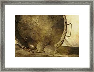 Potatoes In A Basket Framed Print by Dan Sproul