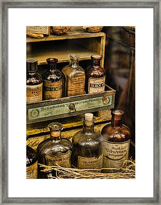Potions And Cure Alls Framed Print