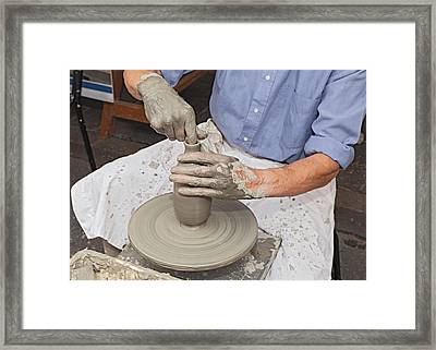 Potter Shaping Clay On A Potter's Wheel  Framed Print by Ermess Images