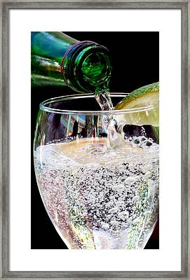 Pouring Bubbles Into Glass Framed Print by Jeff Lowe