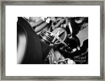 Pouring Fresh New Oil Into Engine Filler In A Car Engine Compartment Framed Print