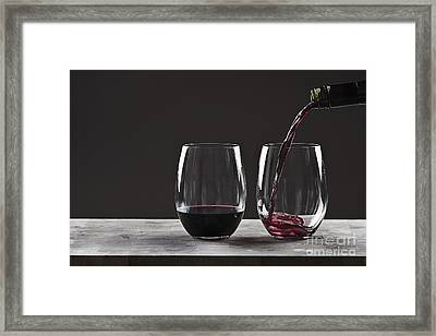Pouring Red Wine Framed Print by Justin Paget