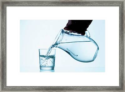 Pouring Water From Jug Framed Print by Wladimir Bulgar