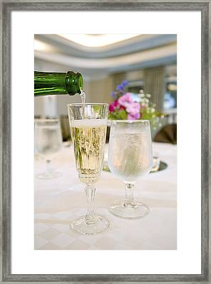 Pouring White Wine Framed Print by M Cohen
