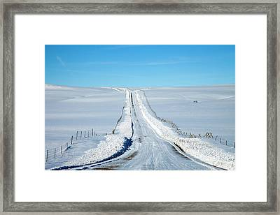 Pov Of Snow Covered Country Road Framed Print by Andrew Geiger