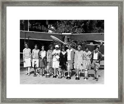 Powderpuff Derby Aviatrix Framed Print by Underwood Archives