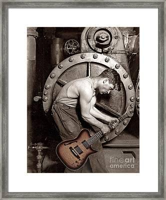Power Chord Mechanic Framed Print by Martin Konopacki