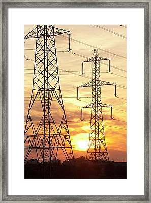 Power Lines And Pylons At Sunset Framed Print by Ashley Cooper