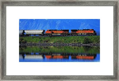 Powering Across Framed Print by Benjamin Yeager