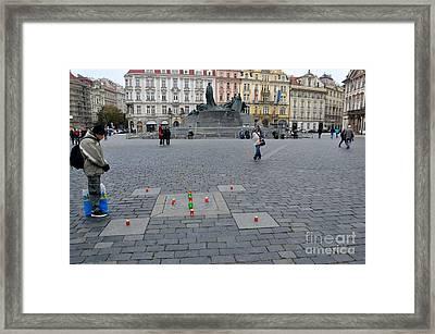 Man In Prayer At Prague Plaza Framed Print