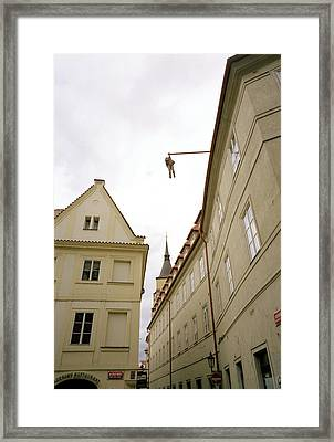 Prague's Hanging Man Framed Print by Shaun Higson