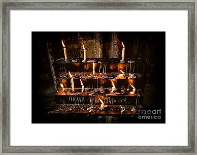 Prayer Candles Framed Print by Adrian Evans
