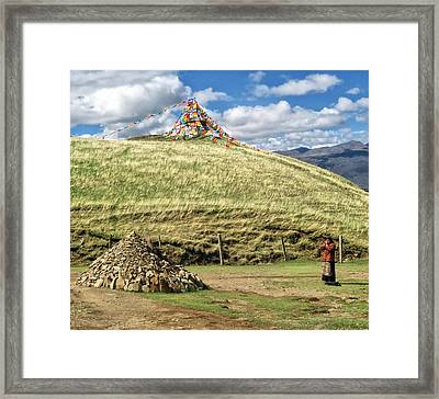 Praying Tibetan Framed Print by James Wheeler