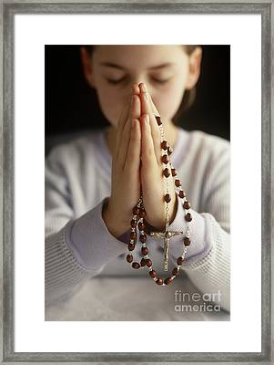 Praying With Rosary Beads Framed Print by Jim Corwin