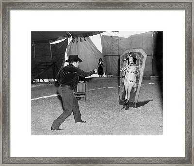 Precision Knife Throwing Framed Print by Underwood Archives