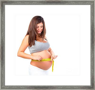 Pregnant Woman Measuring Belly Framed Print